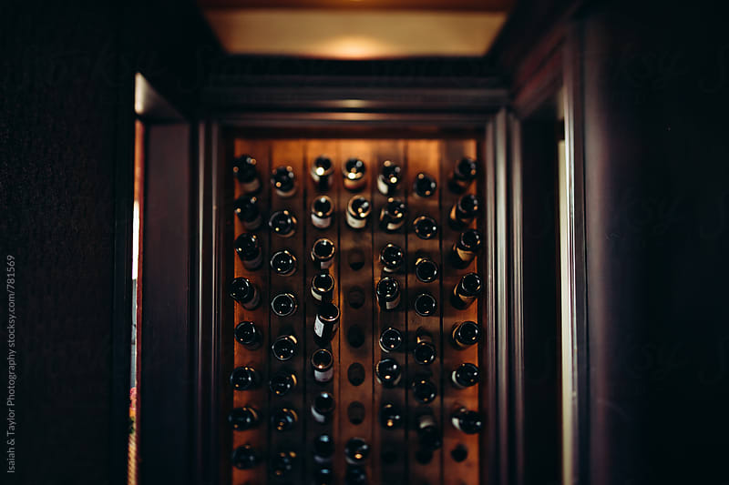 Wine bottle storage in home by Isaiah & Taylor Photography for Stocksy United