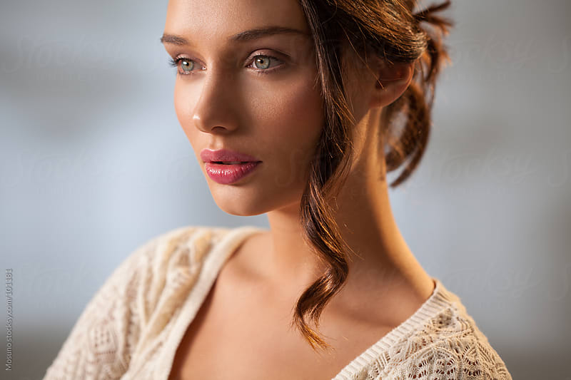 Beautiful Young Brunette Looking Away by Mosuno for Stocksy United