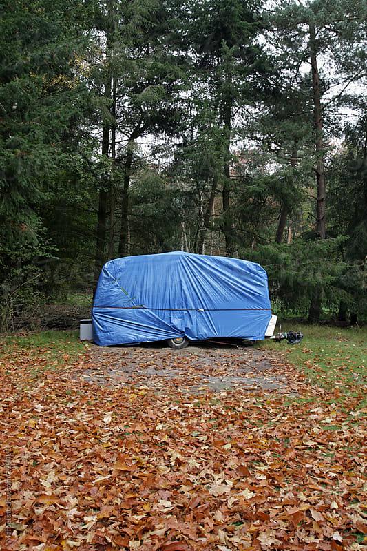 Caravan wrapped in plastic by Marcel for Stocksy United
