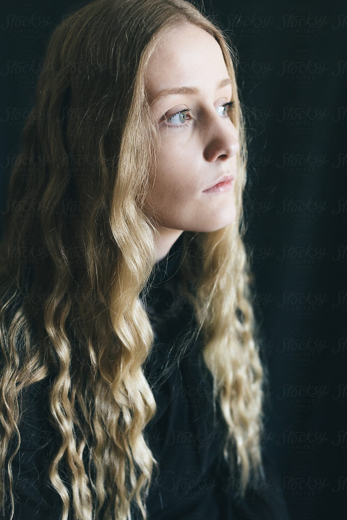 Contemplative teen girl with long blonde hair by Jacqui