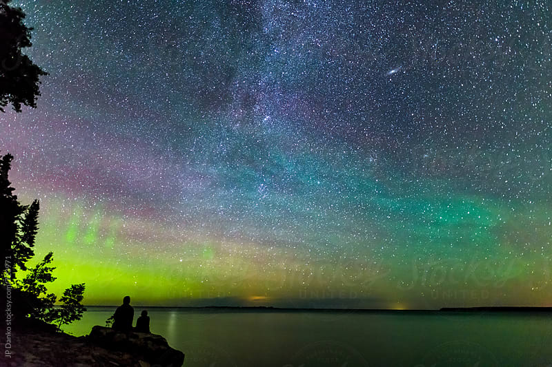 Father & Son Watching Perseids Meteor Shower With Milky Way and Northern Lights in August Summer by JP Danko for Stocksy United