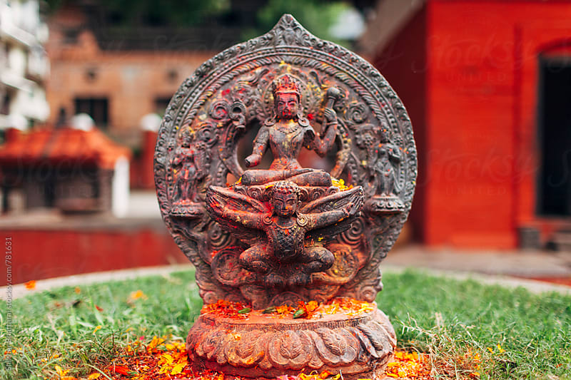 Close up of a statue covered in vermillion powder. by Shikhar Bhattarai for Stocksy United