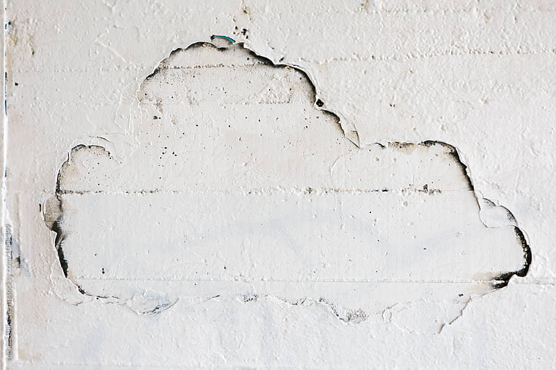 White chipped paint cloud on a white wall by Mihael Blikshteyn for Stocksy United