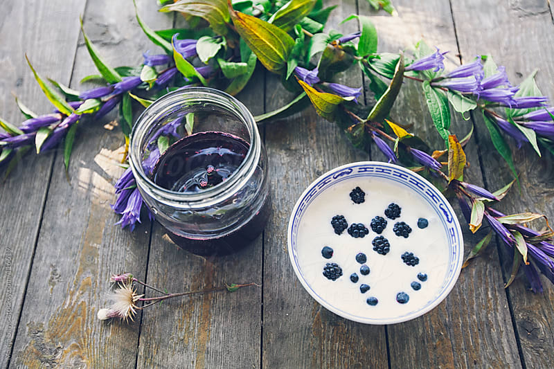 Blueberry juice and yogurt on a wooden table. by Marija Savic for Stocksy United