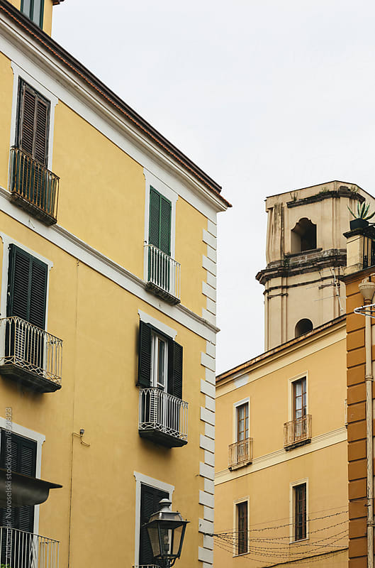 Two yellow buildings in Sorrento, Italy by Aleksandar Novoselski for Stocksy United