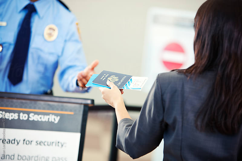 Airport: Giving Passport and Ticket to Security by Sean Locke for Stocksy United