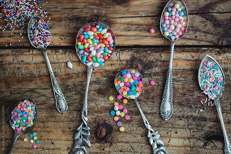 Vintage spoons with cupcake sprinkles by Ruth Black for Stocksy United