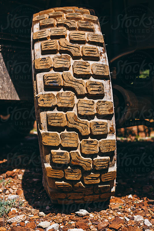 tire tread of an offroad truck by Leander Nardin for Stocksy United
