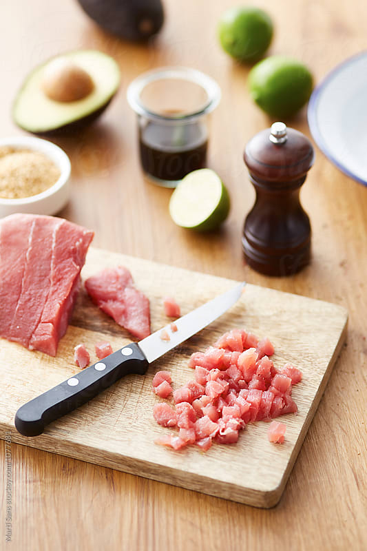 Cut red tuna with other ingredients  by Martí Sans for Stocksy United