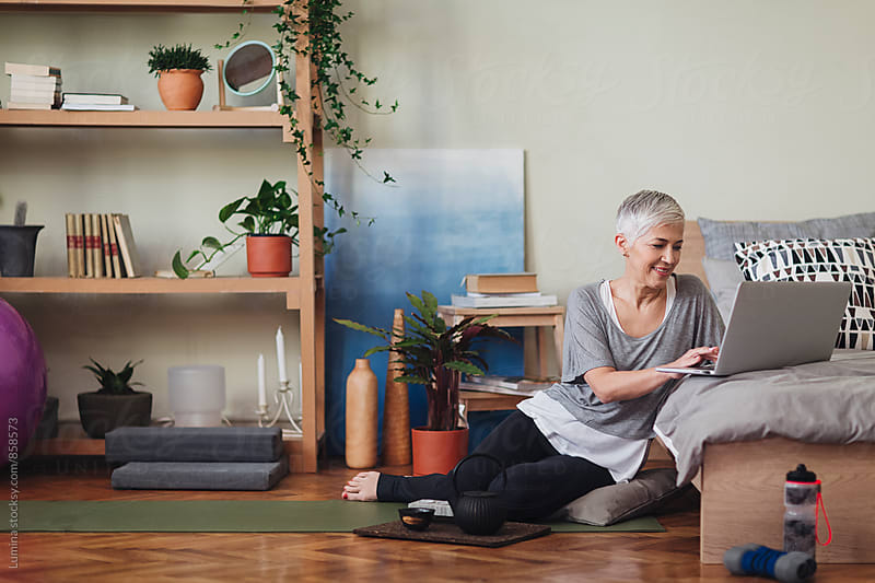 Woman Using a Laptop at Home by Lumina for Stocksy United