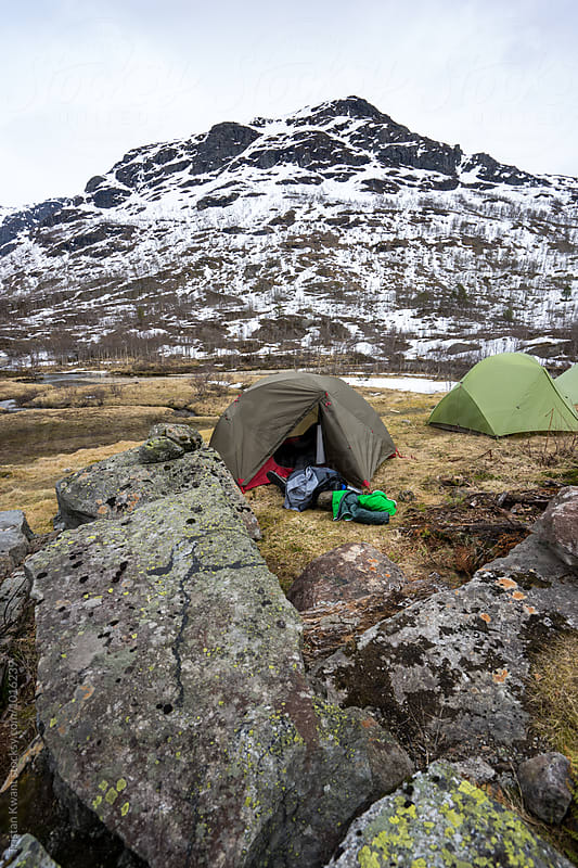 Two tents in the mountains during winter. by Tristan Kwant for Stocksy United