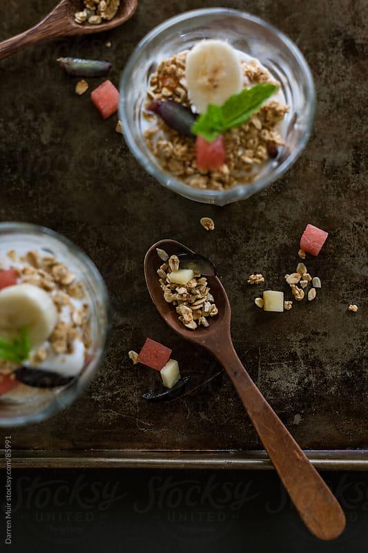 Breakfast of yogurt and granola.  by Darren Muir for Stocksy United