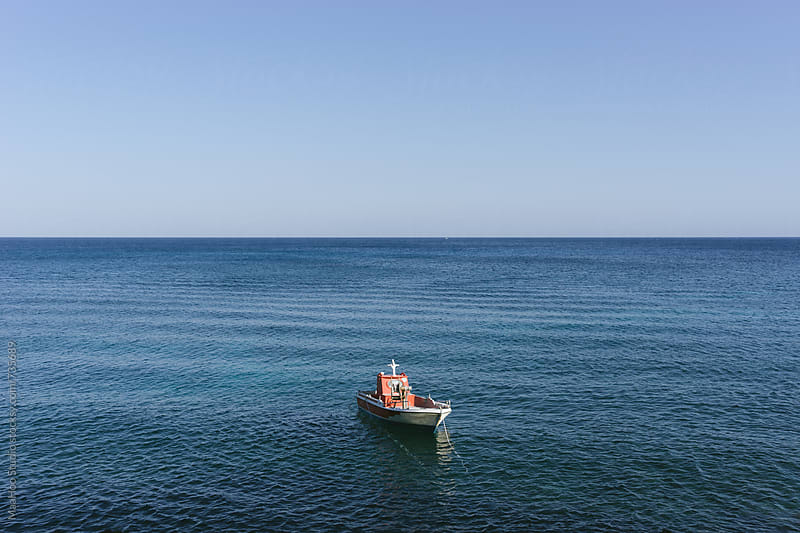 A boat in calm blue mediterranean sea against sky by Maa Hoo for Stocksy United