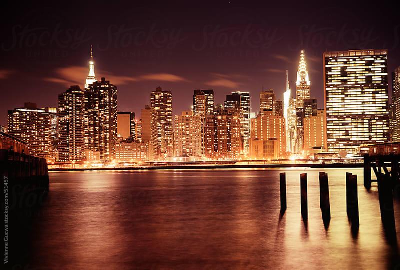 New York City Skyline - Skyscrapers at Night by Vivienne Gucwa for Stocksy United