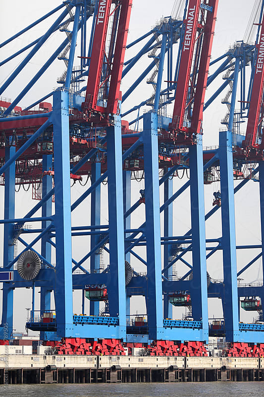 Blue cranes at a huge container terminal in Hamburg by Marcel for Stocksy United