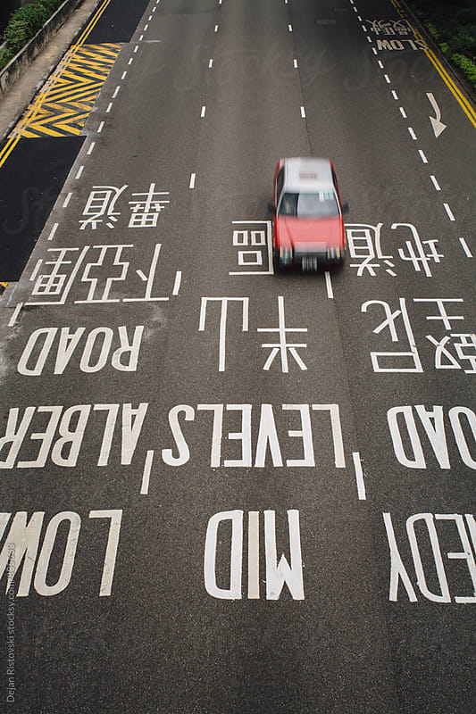 Hong Kong Streets Full of Traffic  by Dejan Ristovski for Stocksy United