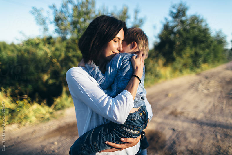 Mother hugging her son by Evgenij Yulkin for Stocksy United