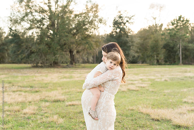 A Baby Girl Laying On Her Mother's Shoulder by Alison Winterroth for Stocksy United