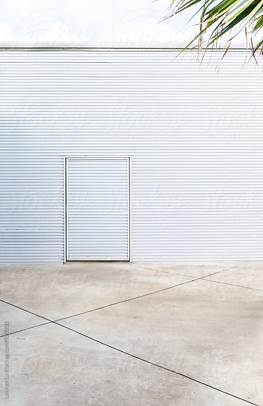 View on metal siding building with door in wall  by Lawren Lu for Stocksy United