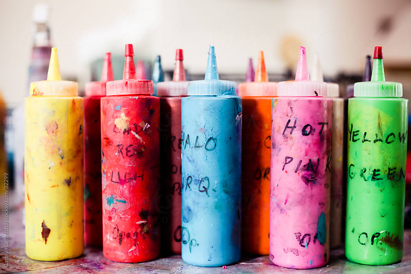 Numerous bottles of paint in the art studio by Carolyn Lagattuta for Stocksy United