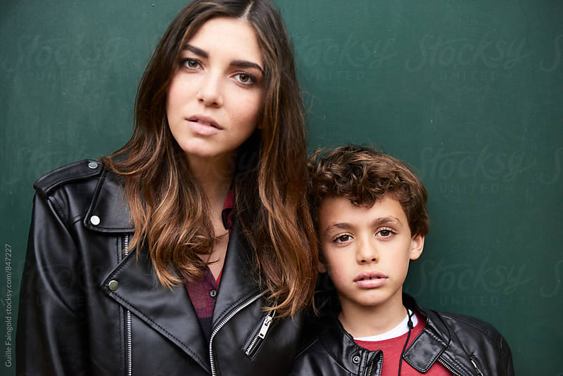 Mother and her boy looking at camera calmly by Guille Faingold for Stocksy United