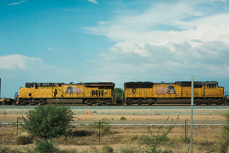 trains passing roadside by Image Supply Co for Stocksy United