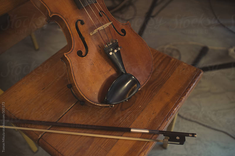 Violin on the chair by Tomas Mikula for Stocksy United