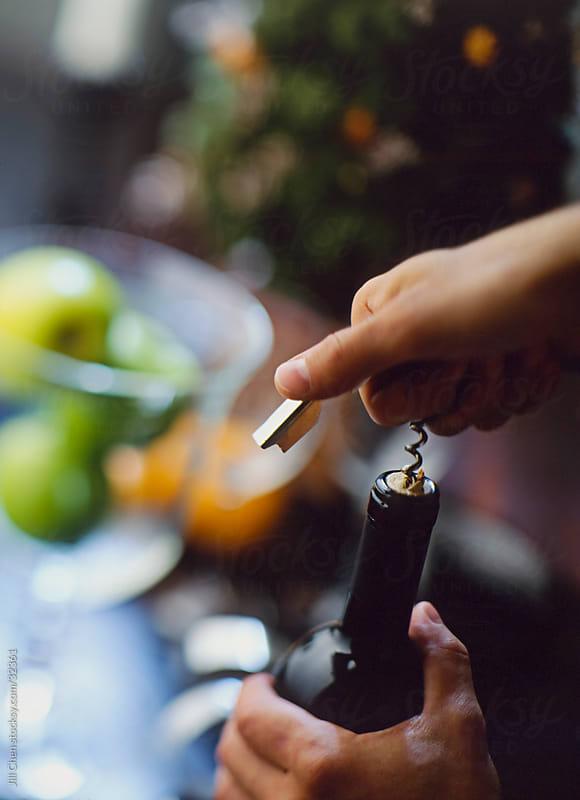 Hands Opening Wine Bottle by Jill Chen for Stocksy United