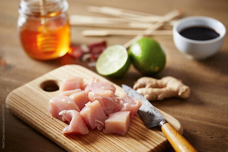 Cutting chicken breast by Martí Sans for Stocksy United