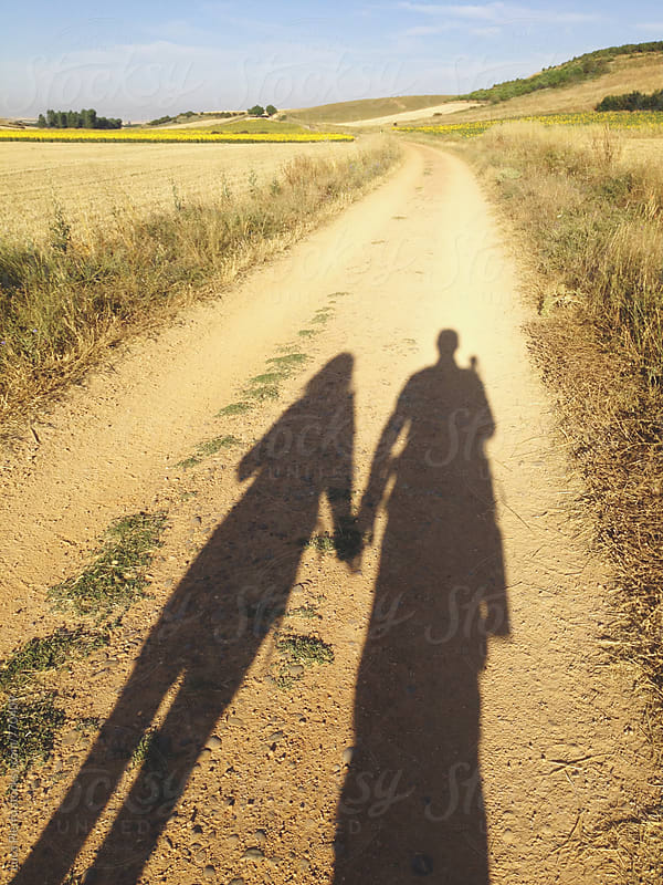 Hikers in love walking the Camino de Santiago by Luca Pierro for Stocksy United