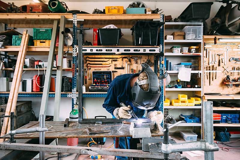 Metal worker welding by Urs Siedentop & Co for Stocksy United