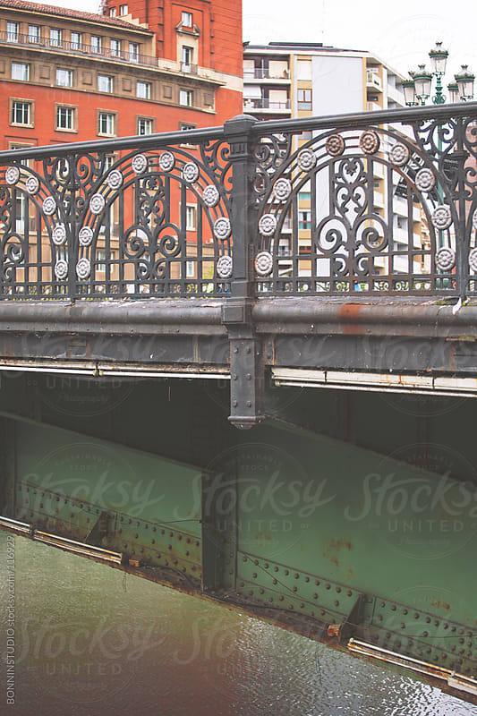 Old bridge on Bilbao river, Spain. by BONNINSTUDIO for Stocksy United