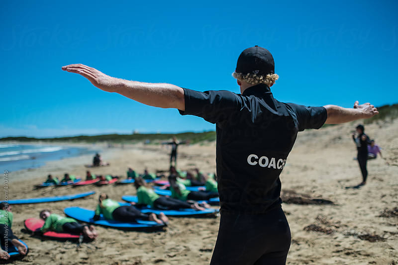 Surf Coach running class by Rowena Naylor for Stocksy United