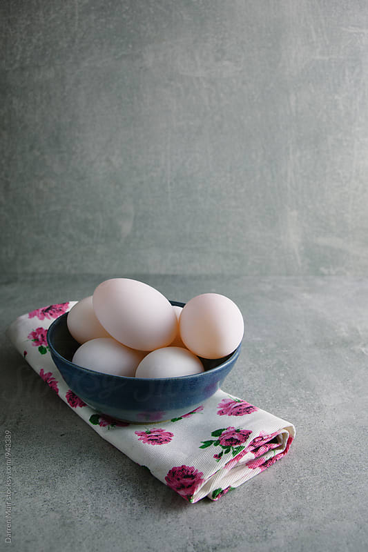 Duck eggs in a blue bowl. by Darren Muir for Stocksy United