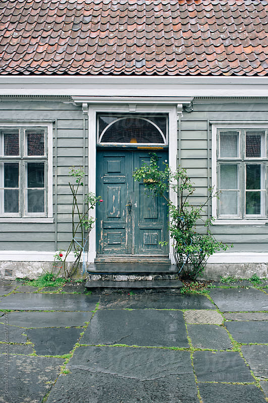 Door entrance to the old wooden house by Tomas Mikula for Stocksy United