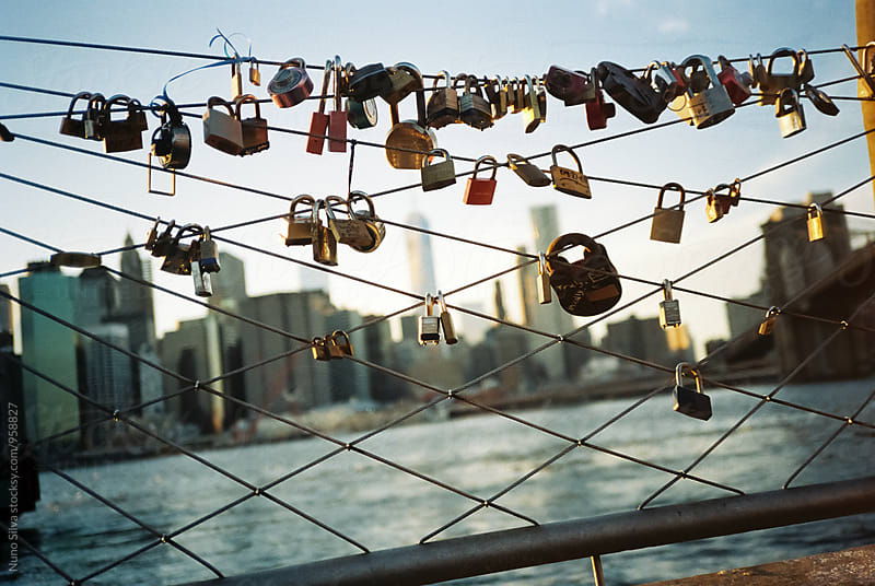 Love Locks on a Fence by Nuno Silva for Stocksy United