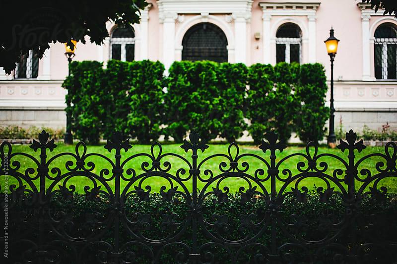 Luxurious residence with iron fence infront by Aleksandar Novoselski for Stocksy United