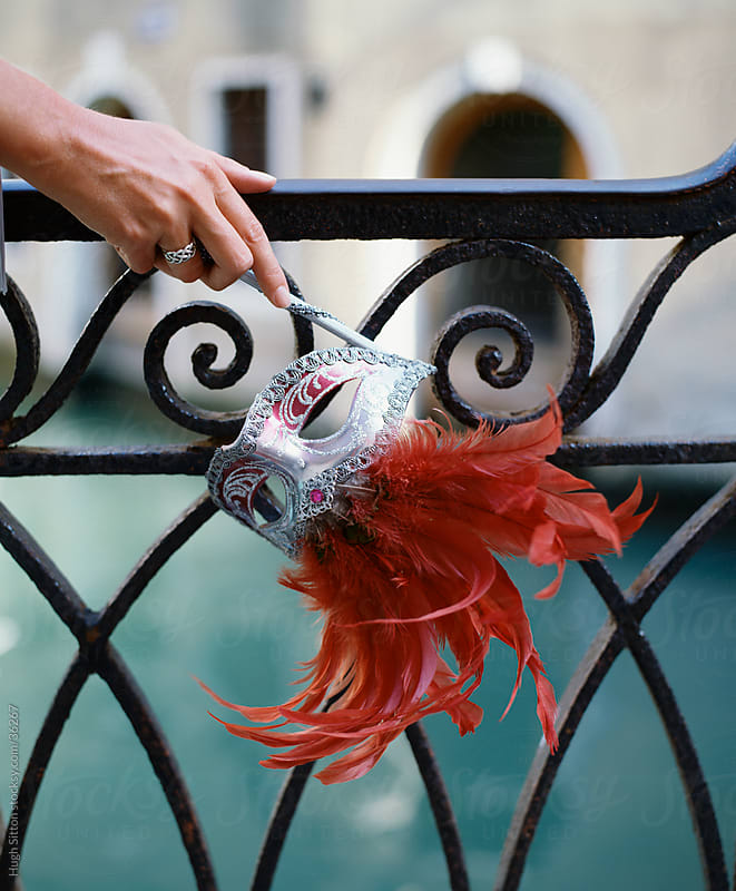 Woman's hand holding venetian mask. Venice. by Hugh Sitton for Stocksy United