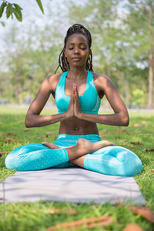 Yoga in a park - beautiful black woman practicing yoga outdoors by Jovo Jovanovic for Stocksy United