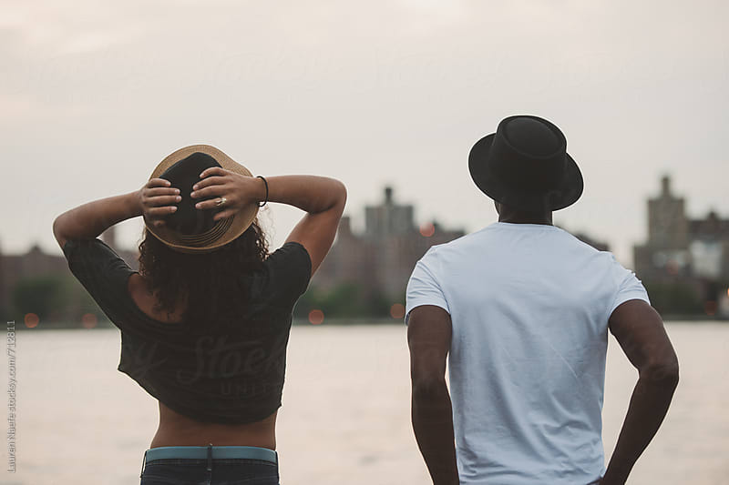 Couple looking at Manhattan skyline by Lauren Naefe for Stocksy United