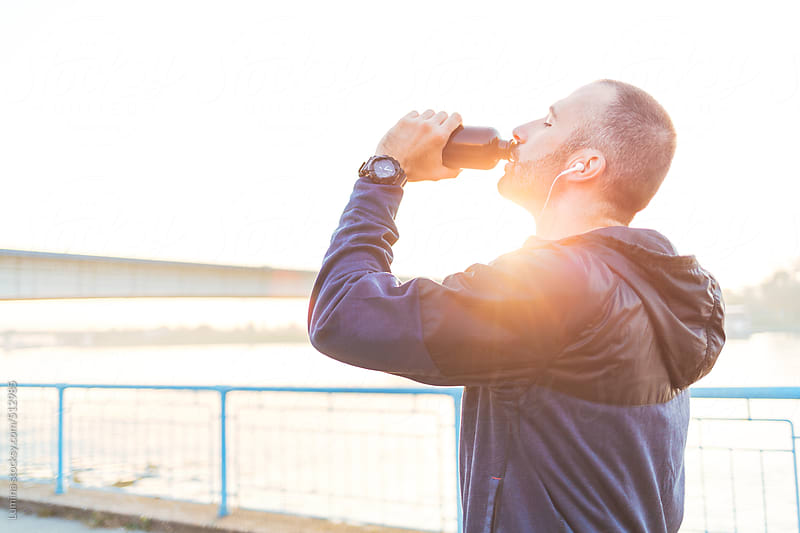 Runner Drinking Water by Lumina for Stocksy United