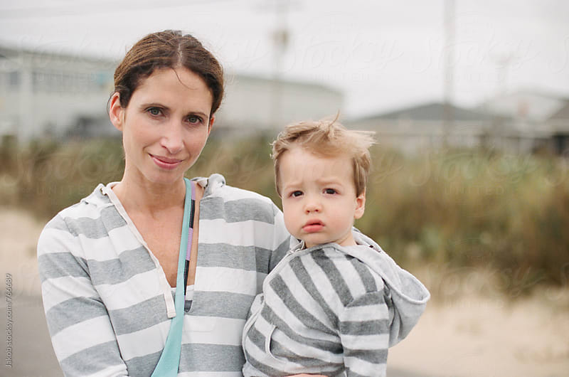 Portrait of a mother and boy toddler on the beach by Jakob for Stocksy United