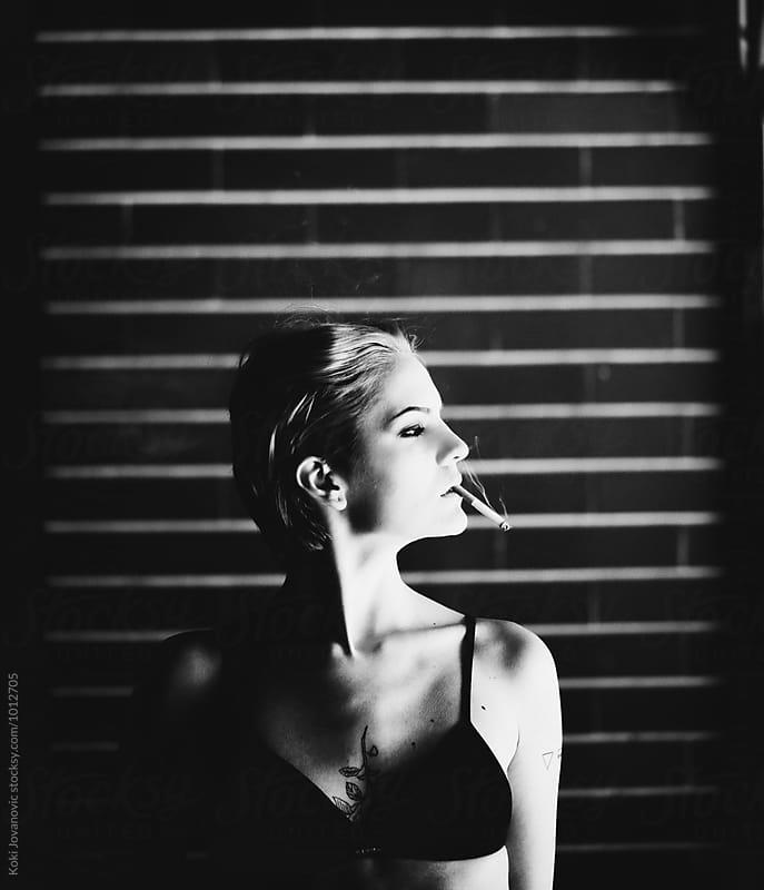 fashion black and white portrait of a girl by Koki Jovanovic for Stocksy United