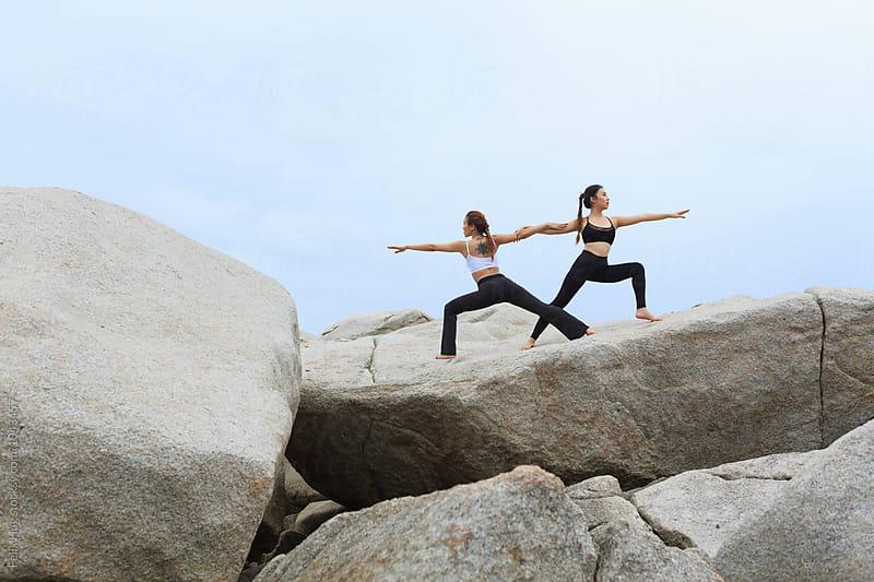 Two asian women doing Yoga by Felix Hug for Stocksy United