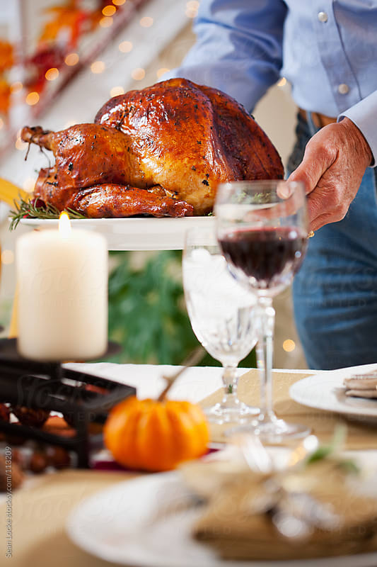 Thanksgiving: Bringing The Turkey On A Platter by Sean Locke for Stocksy United