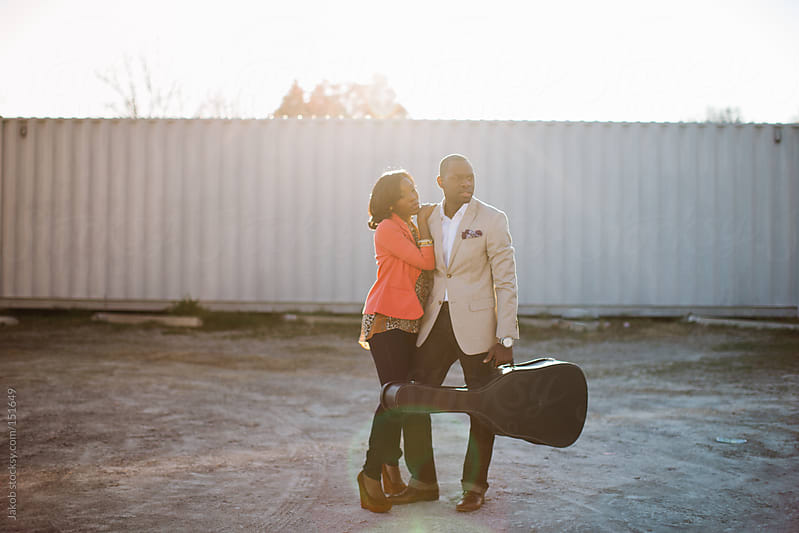 A beautiful african-american couple outside with a guitar by Jakob for Stocksy United