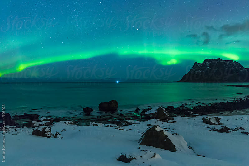 Aurora Borealis over Uttakleiv Beach by Marilar Irastorza for Stocksy United
