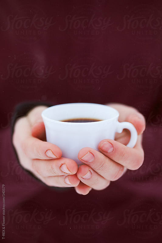Woman holding tea cup by T-REX & Flower for Stocksy United