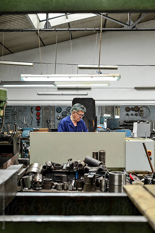 Senior man working in a metal workshop by Bisual Studio for Stocksy United