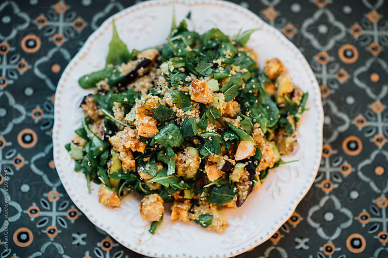 Quinoa and chicken salad with argula by Adrian Cotiga for Stocksy United